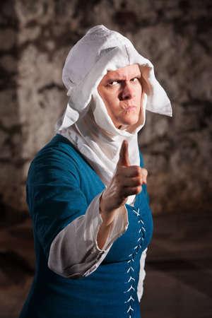 Angry European renaissance nun with pointing finger Banco de Imagens