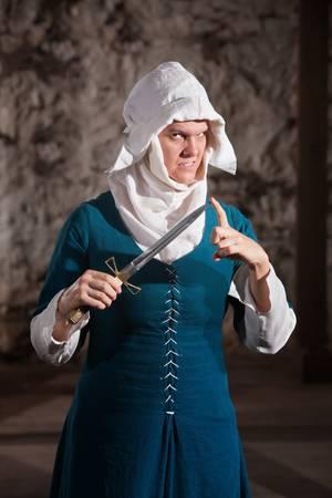 finger tip: Dangerous European nun with finger tip of dagger