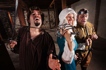 swashbuckler: Tough medieval lady with king and sword on mans neck