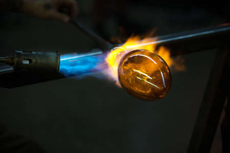 Close up of flame from blowtorch on new glass art piece Stock Photo - 18724673