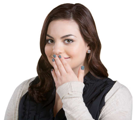 bashful: Smiling Caucasian young adult with fingers on mouth