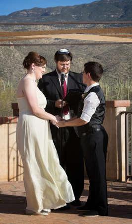 Rabbi blessing lesbian marriage ceremony in desert