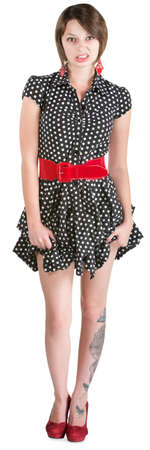 disgusted: Disgusted young woman holding her polka dot dress