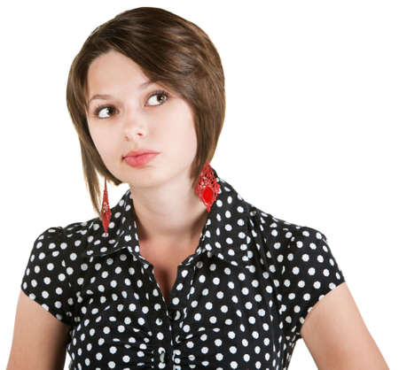 Pensive woman in polka dots over white background