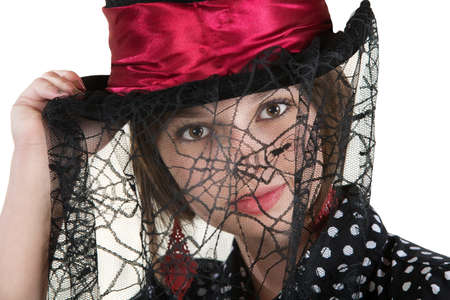 Cute young woman with spider web veil and red hat