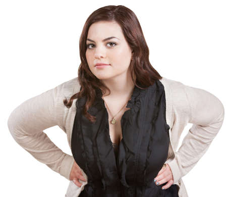 leaning forward: Young Caucasian female with hands on hips leaning forward Stock Photo