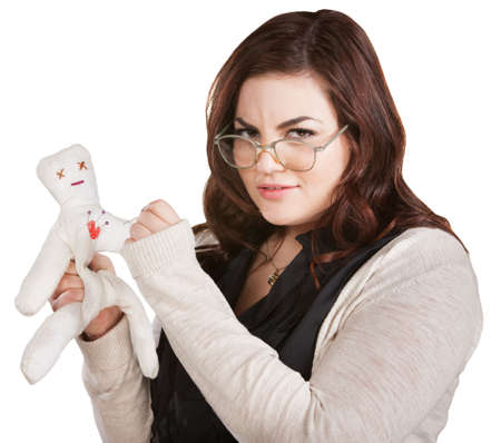 insulted: Mad woman with eyeglasses sticking doll with needle