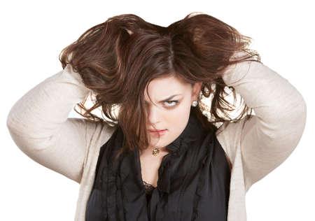 aggravated: European woman on white holding messy hair