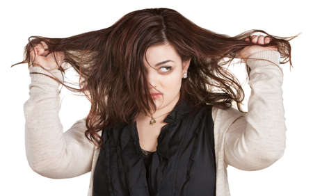 bad hair day: Woman looking over while pulling messy hair