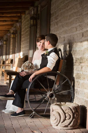 Admiring young lesbian married couple sitting outdoors Stock Photo - 19144218
