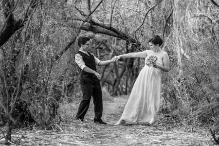 Happy committed couple dancing in the forest together Stock Photo - 19144199
