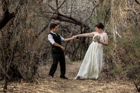 Married same sex couple dancing in the forest together Stock Photo - 19144200