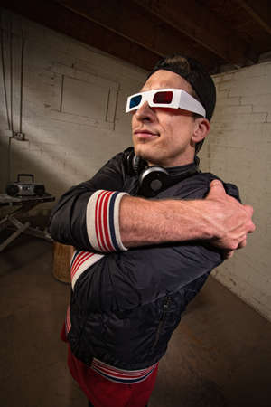 Funny man with folded arms and 3D glasses photo