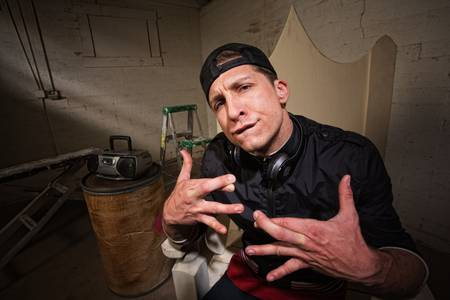Urban musician with crossed fingers and goofy expression Stock Photo - 19144210