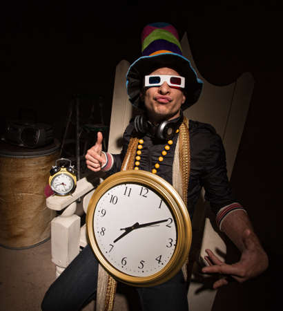 Funny white rapper with multi colored hat and large clock Stock Photo - 19144230