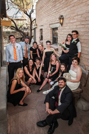 Same sex wedding group sitting outside near brick wall Stock Photo - 19248364