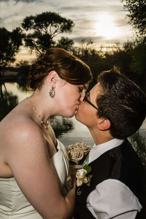 Loving same sex married couple kissing near lake Stock Photo - 19248353