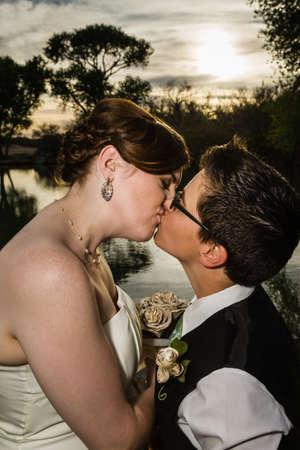 Loving same sex married couple kissing near lake Stock Photo - 19248353
