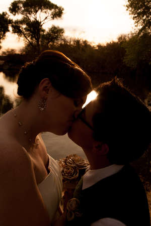 Romantic lesbian couple kissing near sunset outdoors Stock Photo - 19242544