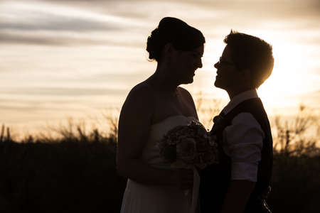 Adult same sex couple looking at each other at sunrise Stock Photo - 19242538