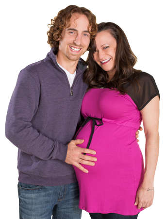 Smiling expecting parents over isolated white background Stock Photo - 19242552
