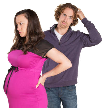 Man next to pregnant woman scratching his head photo