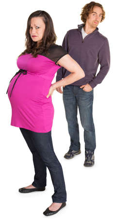 gullible: Moping pregnant woman with naive man with hands in pockets