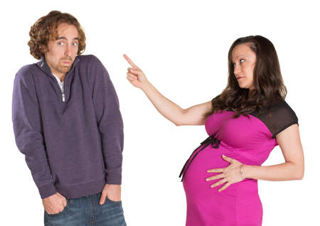 Pregnant woman pointing finger at man with hands in pockets Stock Photo - 19242531