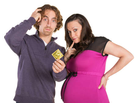 Man and pregnant woman looking confused with condom photo