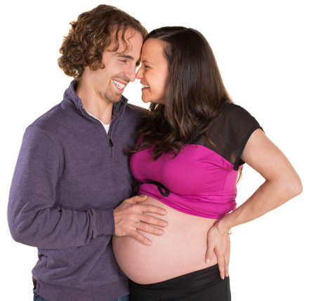 Happy expecting couple touching noses on isolated background Stock Photo - 19242537