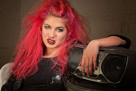 disrespectful: Moody teenage European female with pink hair and radio