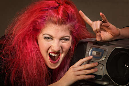 cd player: Yelling young woman with pink hair and radio