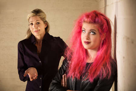 indifferent: Indifferent European mother with daughter in pink hair Stock Photo