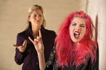 middle aged: Angry parent with loud teenager with pink hair