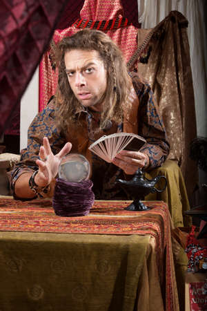 Stoic handsome gypsy man with crystal ball Stock Photo - 20529788