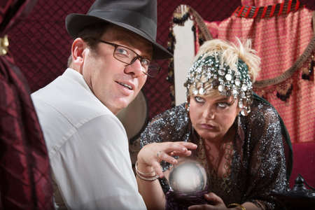 soothsayer: Businessman with eyeglasses with crystal ball fortune teller