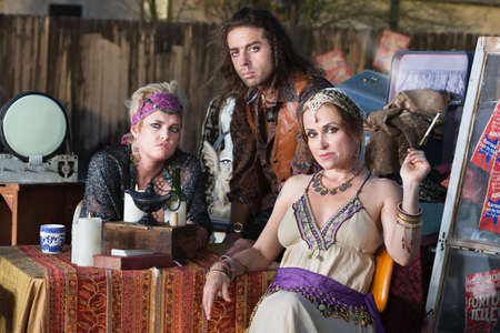 laid back: Three good looking fortune tellers outside with magic lamp Stock Photo
