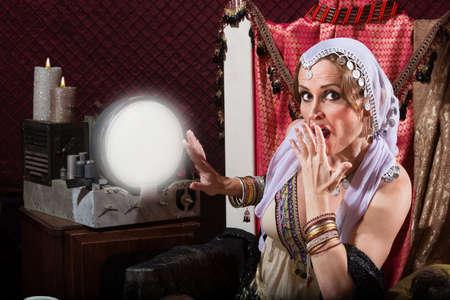fortune teller: Startled sexy female fortune teller in headscarf Stock Photo