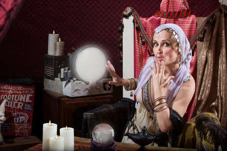 fortune teller: Beautiful fortune teller with hand over her mouth