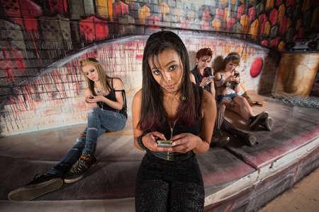 pda: Beautiful Hispanic female teenager using cell phone Stock Photo