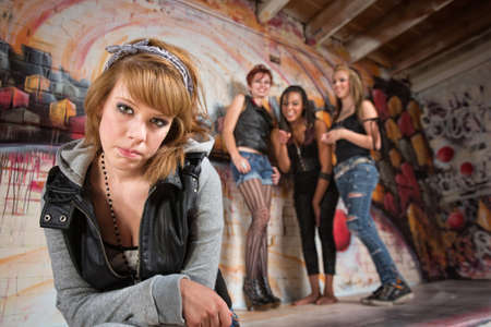bashful: Bashful young woman being teased by group of teenagers