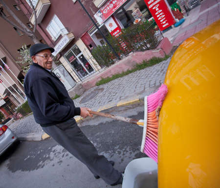 ANKARA, TURKEY - APRIL 15: Cab driver washes taxi prior to ANZAC day on April 15, 2012 in Ankara, Turkey.  Each year patriotic Turks honor those fallen at the battle of Galipoli during World War I.