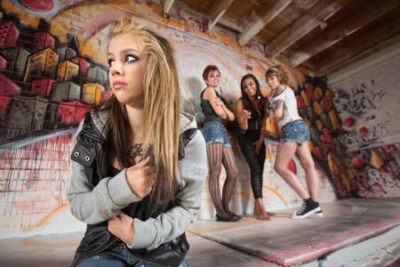 Insecure European teenager being bullied by female gang Stock Photo