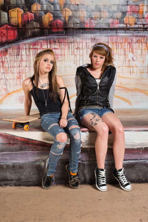 irked: Tough pair of white female gang members Stock Photo