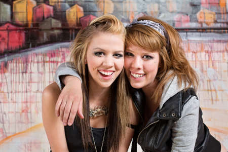 bff: Pretty pair of female youths embracing together