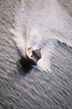 speedboat: Police Boat on Patrol Moving Fast with Large Wake