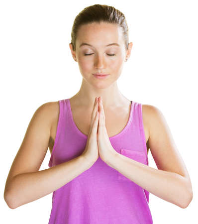 Athletic young woman with eyes closed praying photo