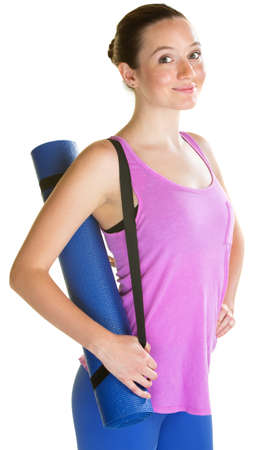 straps: Confident young woman carrying yoga mat on isolated background