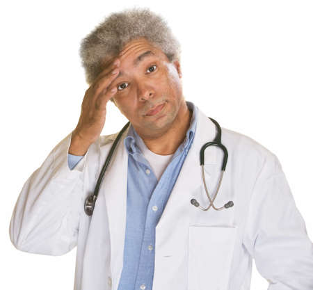 doctor stress: Concerned medical doctor with hand on forehead