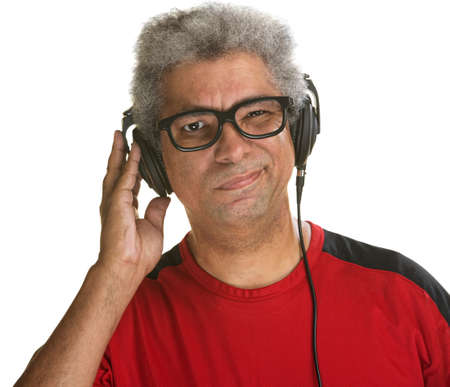 Handsome mature African man squinting with headphones